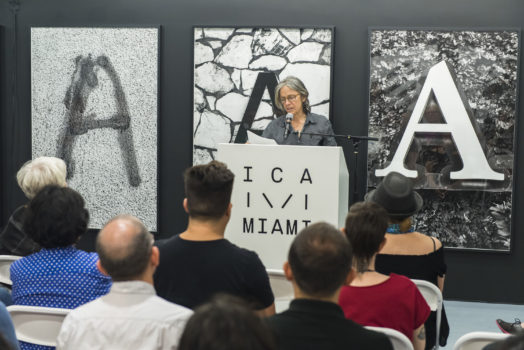 Image of the renown poet Eileen Myles reading poetry during ICA IDEAS, ICA Miami