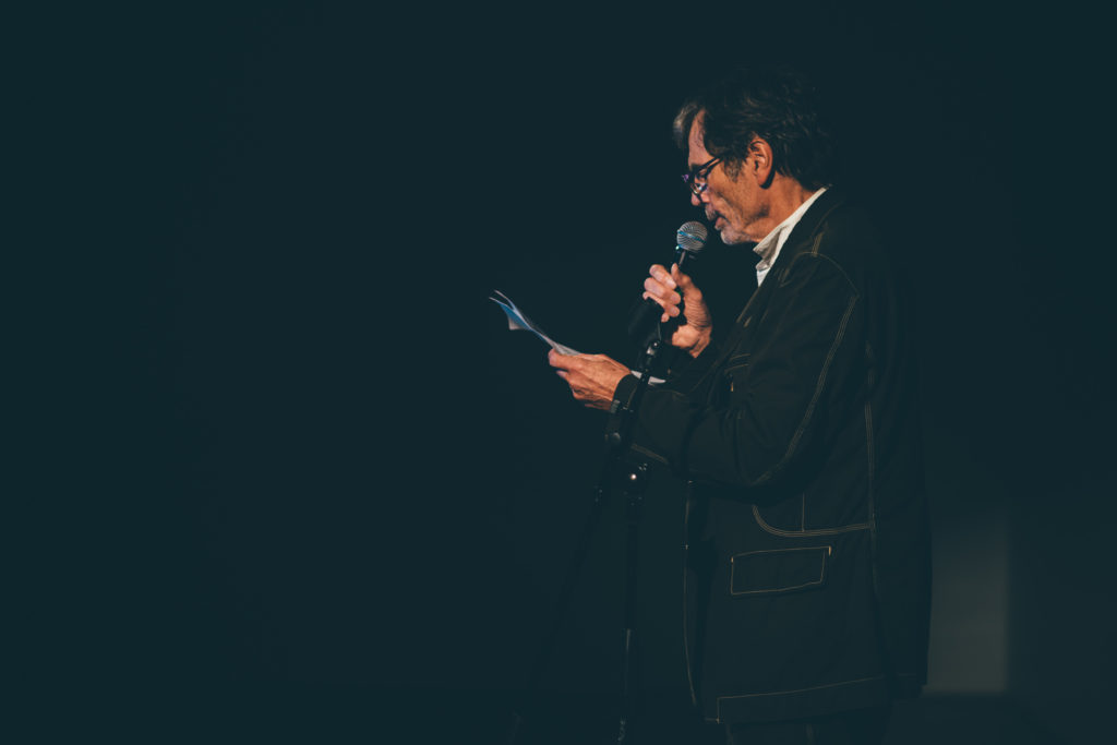 Image of Richard Tuttle reading a poem during ICA Speaks, ICA Miami