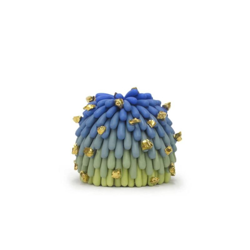Linda Lopez, Blue/Green Ombre Dust Furry with Gold Rocks #1, 2018. Porcelain and gold luster. Courtesy the artist and Mindy Solomon Gallery, Miami.