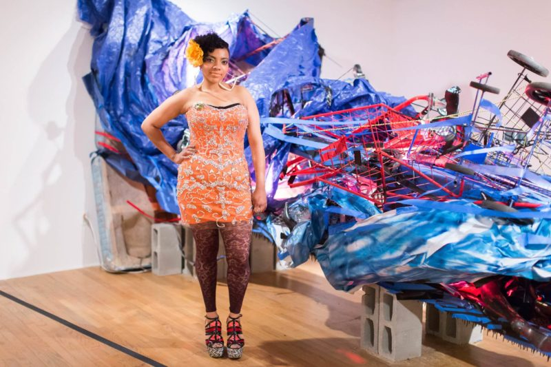 Abigail DeVille in front of her sculpture at the Studio Museum in Harlem. Courtesy the artist. Photographed for Miami Indulge Magazine.