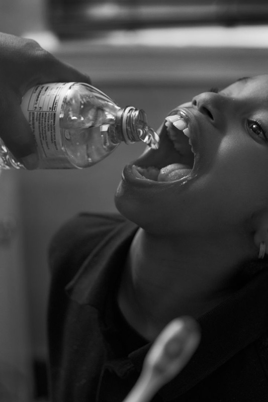 LaToya Ruby Frazier, Shea brushing Zion's teeth with bottled water un her bathroom, 2016/2017